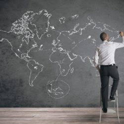 A business drawing world map on a chalkboard, used to depict international business in an article about MBA specialization