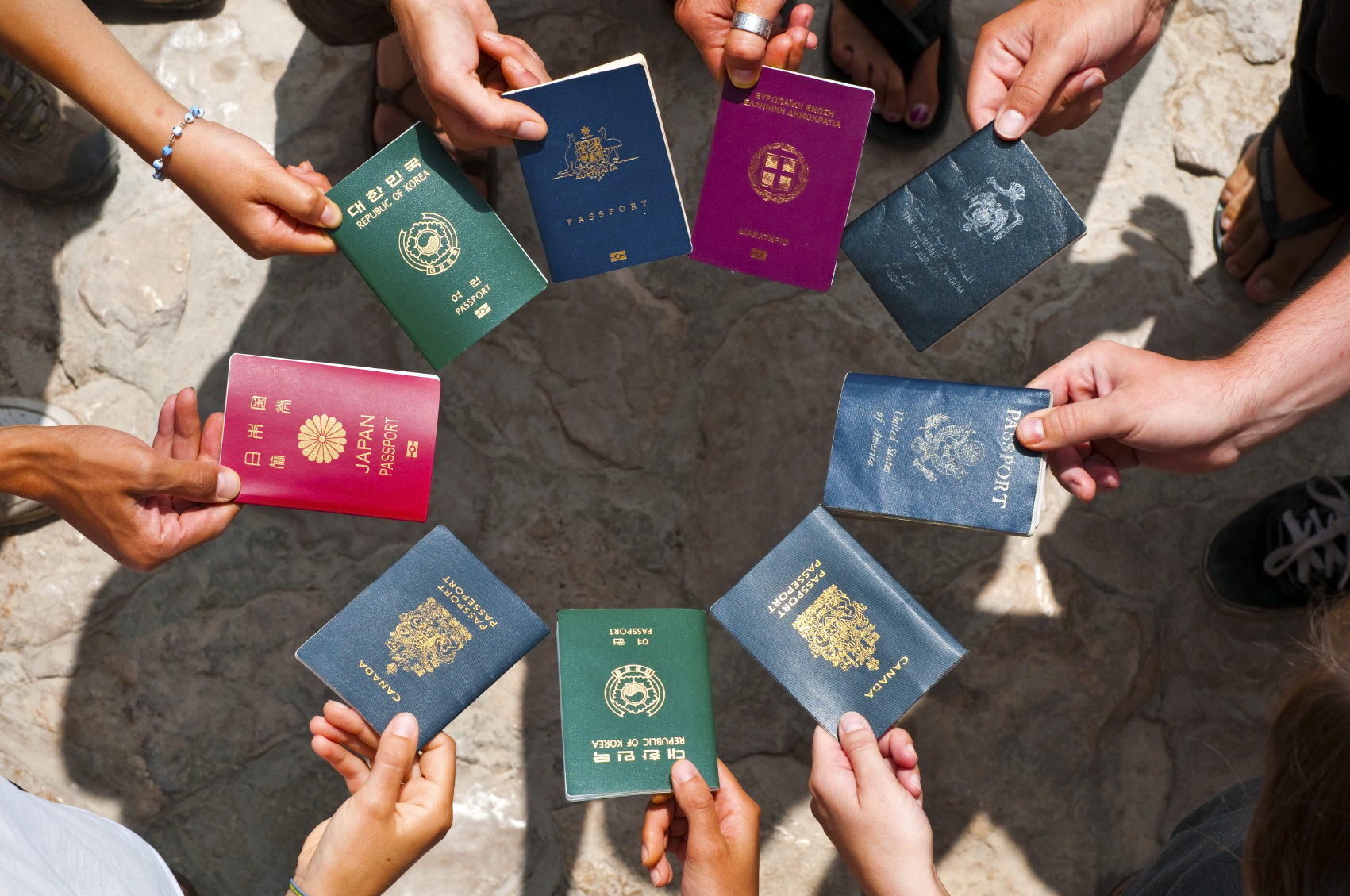 passports from around the world being presented in a circle