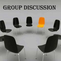 A group of chairs in a circle – one orange and others black, denoting an outstanding individual within a group.
